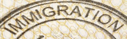 Immigration entry stamp on the inside page of a passport.